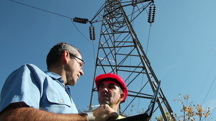 Electricians Under the High Voltage Tower