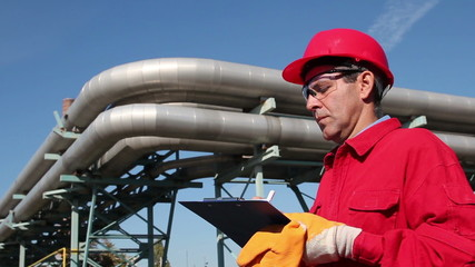 Oil Refinery Worker in Red Overalls