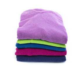 Stack of colorful wool sweaters