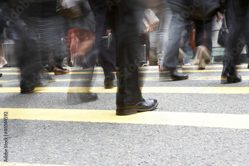Close Up Of Commuters Feet Crossing Busy Hong Kong Street
