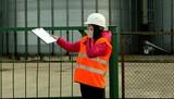 Woman factory worker talking on a walkie-talkie poster