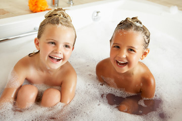Two Girls Playing In Bath Together