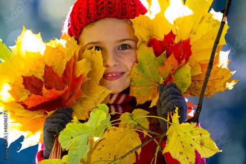 Autumn fun - lovely girl playing in autumn park - 46046375
