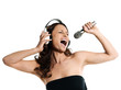 Portrait of a beautiful woman with microphone and headphones sin