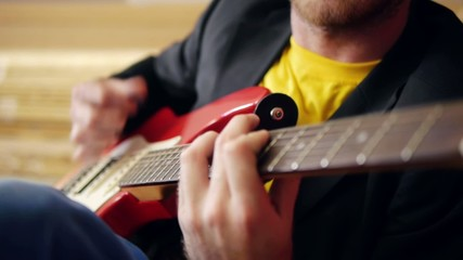 Musicians hands  playing song  on electric guitar