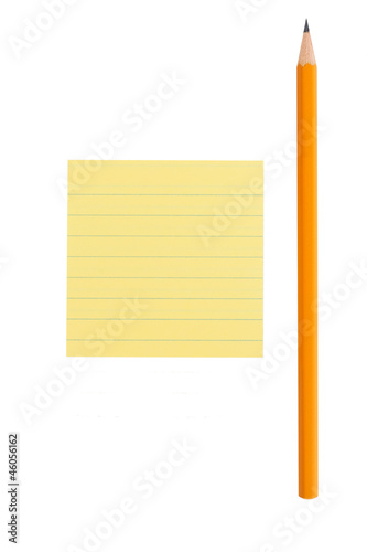 Sharp pencil and yellow post-it note