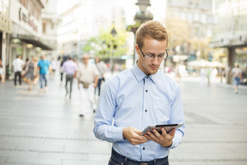 Businessman read news on Tablet Computer