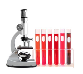 Medical test tubes with blood in holder and microscope on white