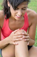 Woman suffering pain knee