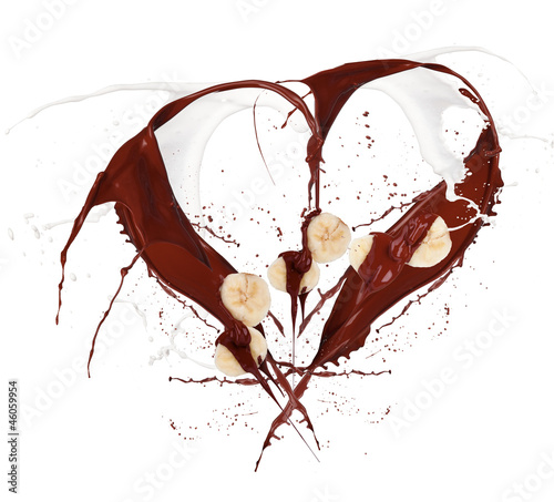 Heart symbol made of chocolate and milk splashes with banana