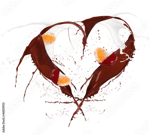 Heart symbol made of chocolate and milk splashes with mandarin