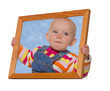 Baby holding a frame around her head