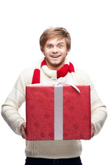 young funny man holding christmas gift