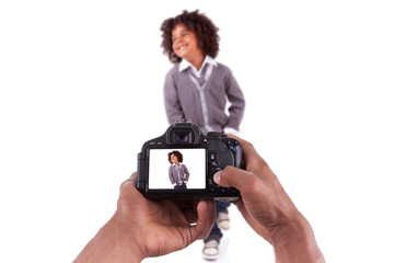 African american photographer taking studio pictures