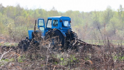 tractor plowing at spring