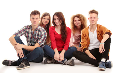 Group of happy young people isolated over white background