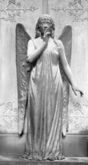 angelic figure in front of the tomb with gesture of silence , mo