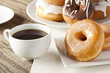 Fresh Homemade Donuts with Black Coffee