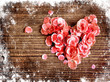 vintage heart from flowers on wooden table