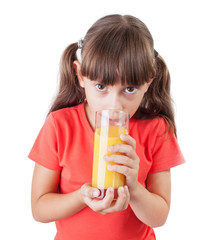 Little girl with an appetite drinking juice