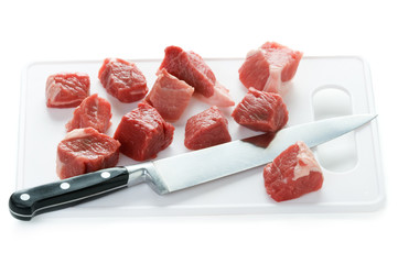 dicing raw lamb with a kitchen knife