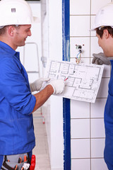 Electricians with installation plan
