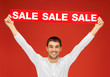 handsome man with sale sign