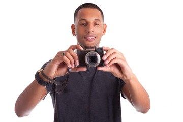 Portrait of a young african american man holding and taking a pi