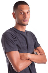 Portrait of a young african american man with folded arms