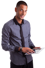 Young african american man using a tablet pc