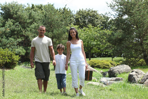 Family strolling in the park