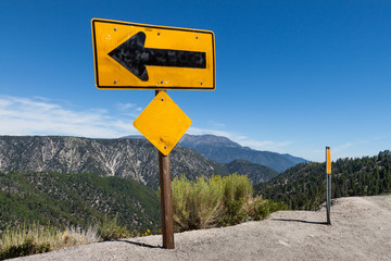 Arrow sign on top of high altitude cliff