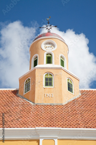 Old clock roof tower with cockerel wind vane