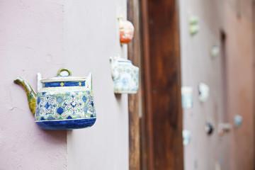 A teapot embedded into the facades of tea-shop