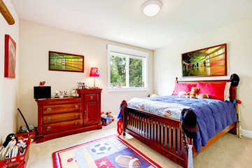 Baby boy Bedroom with wood furniture and colorful art.