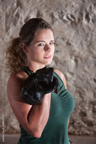 Strong Lady Holds Kettlebell