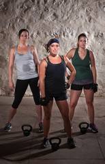 Standing Women Doing Boot Camp Style Workout
