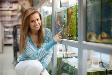 Woman chooses  fish tank