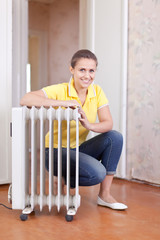 woman near oil heater