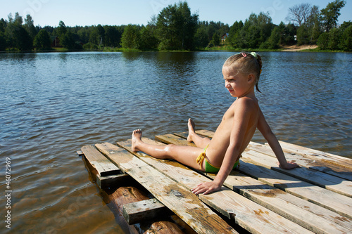 Little girl sits on a raft