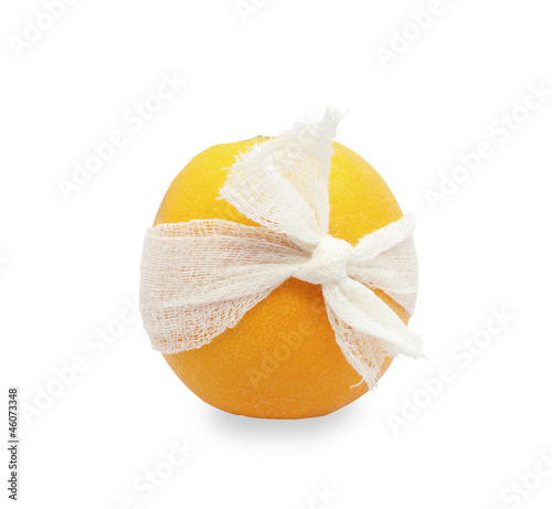 orange with a bandage. Isolated on white.