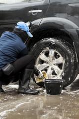 A man washing the car