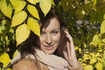 Beautiful woman with yellow leaves