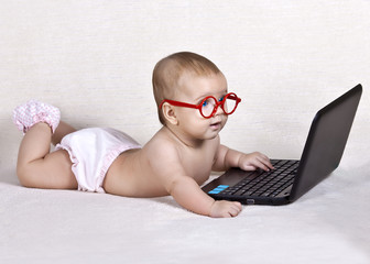 Funny kid with a laptop