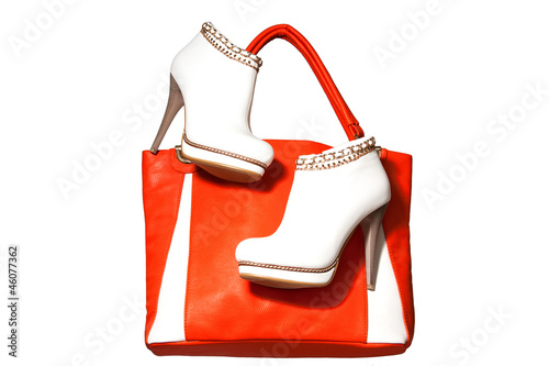 A pair of women's ankle boots and handbag