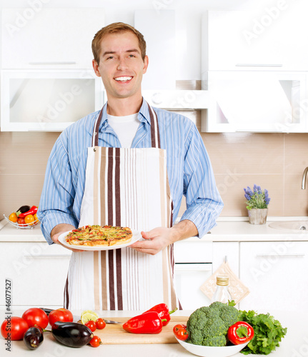 Young Man Cooking Pizza. Home. Kitchen