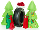 A winter tyre with santa hat as a gift for Christmas