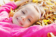 girl lying on yellow leaves
