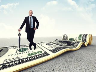 smiling businessman on dollar carpet