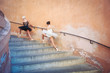 Young beautiful ballerinas dancing on the stairs. Ballerina proj